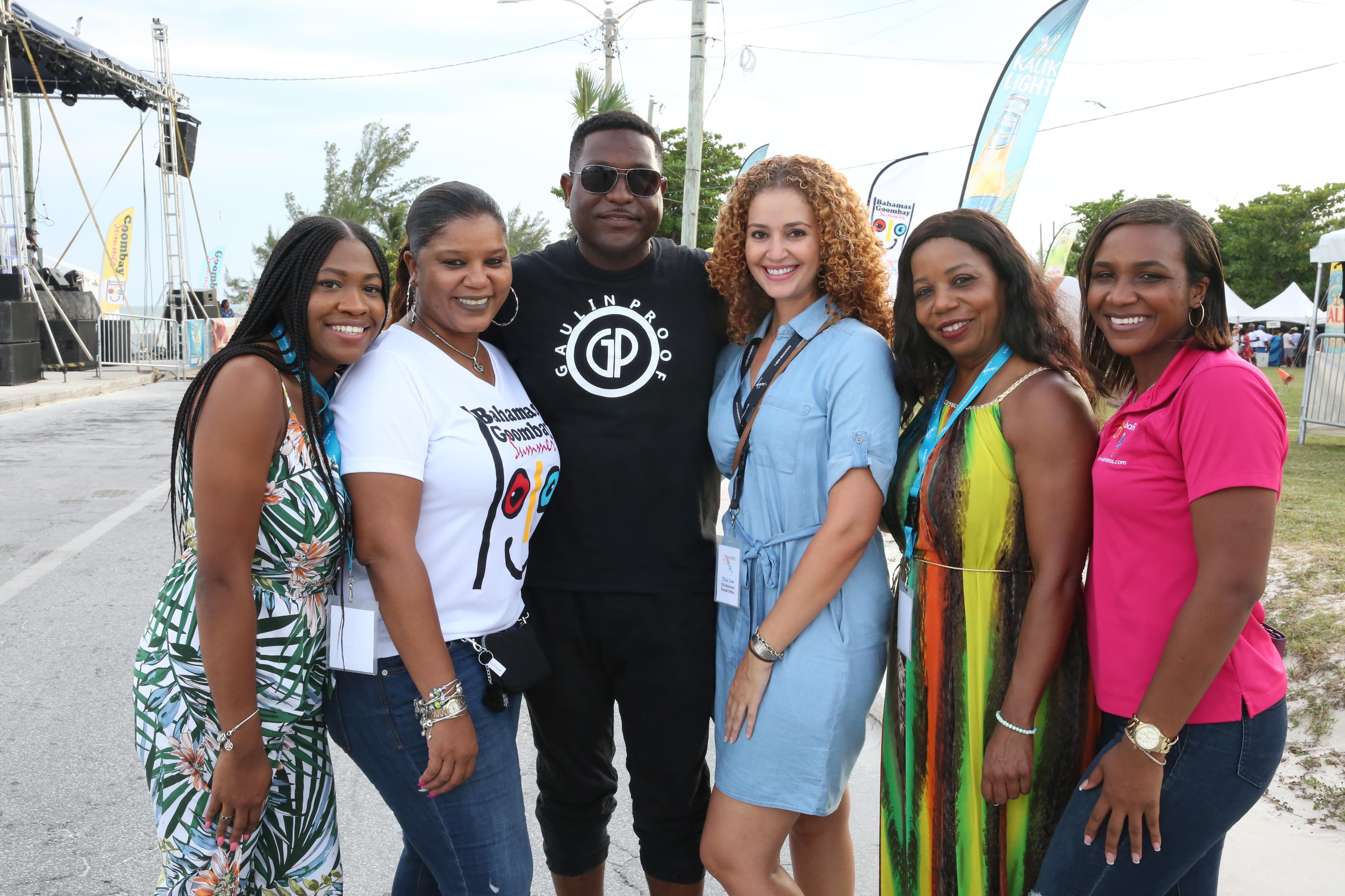 Shown from left to right at the Goombay Summer Festival in Freeport is Phylia Shivers BTO Florida; Sanique Culmer Bahamas Ministry of Tourism & Aviation  Freeport; D-Mac, entertainer; Tina Lee BTO Florida; Anita Johnson-Patty, BTO-Global Communications; a