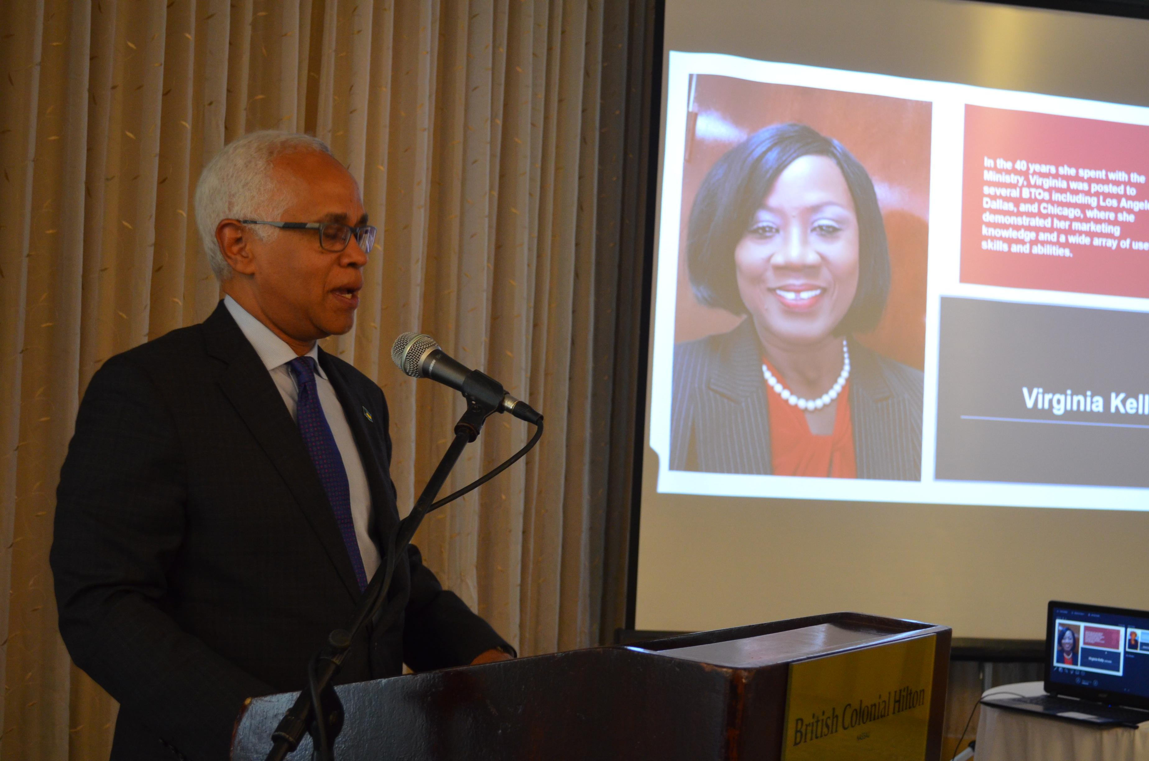 Minister of Tourism, Hon. Dionisio D'Aguilar shares farewell remarks at the ceremony and luncheon