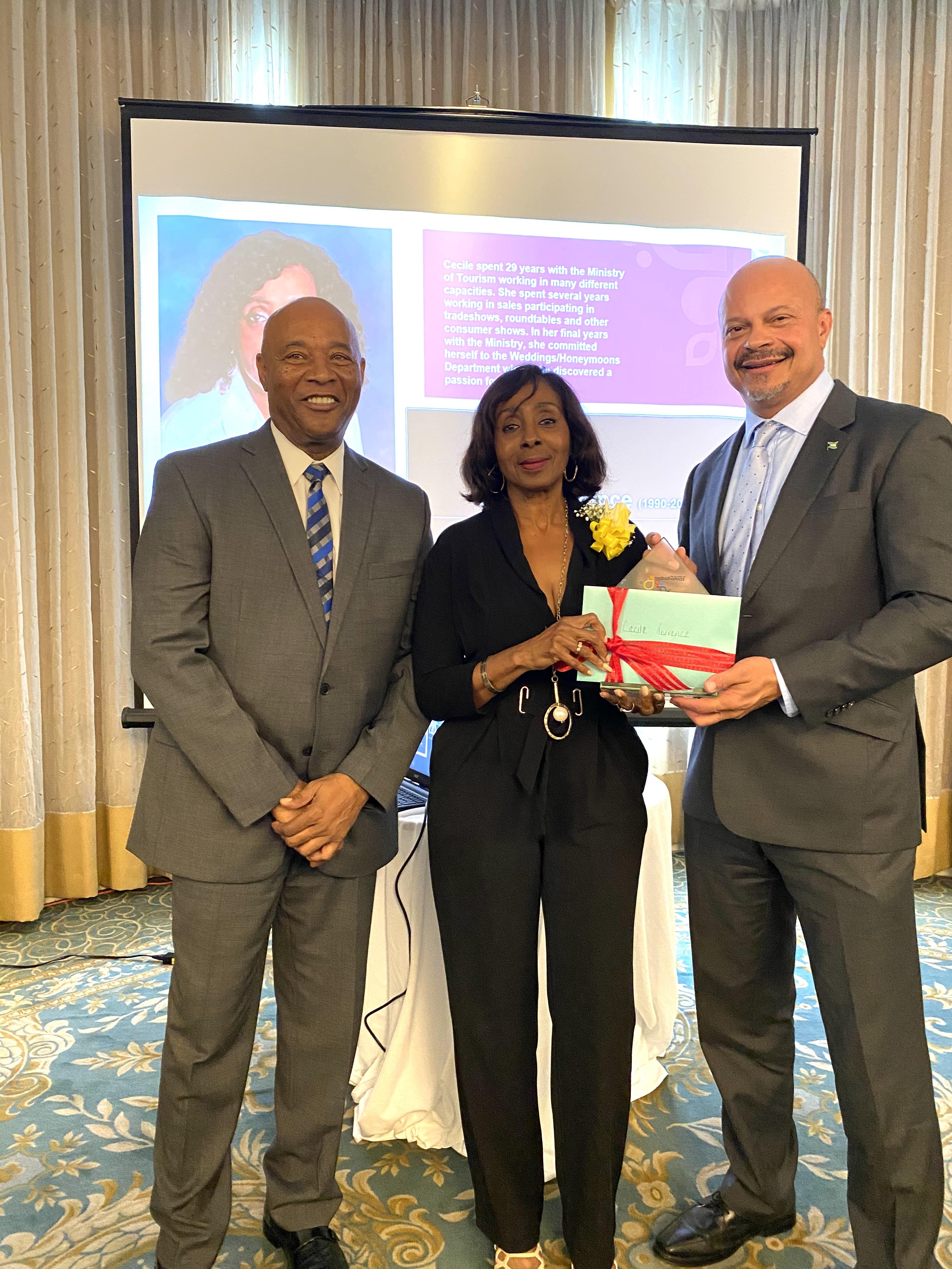 """Honouree Cecile Torrence along with BMOTA Permanent Secretary Charles Albury and Deputy Director General, Ellison """"Tommy"""" Thompson"""