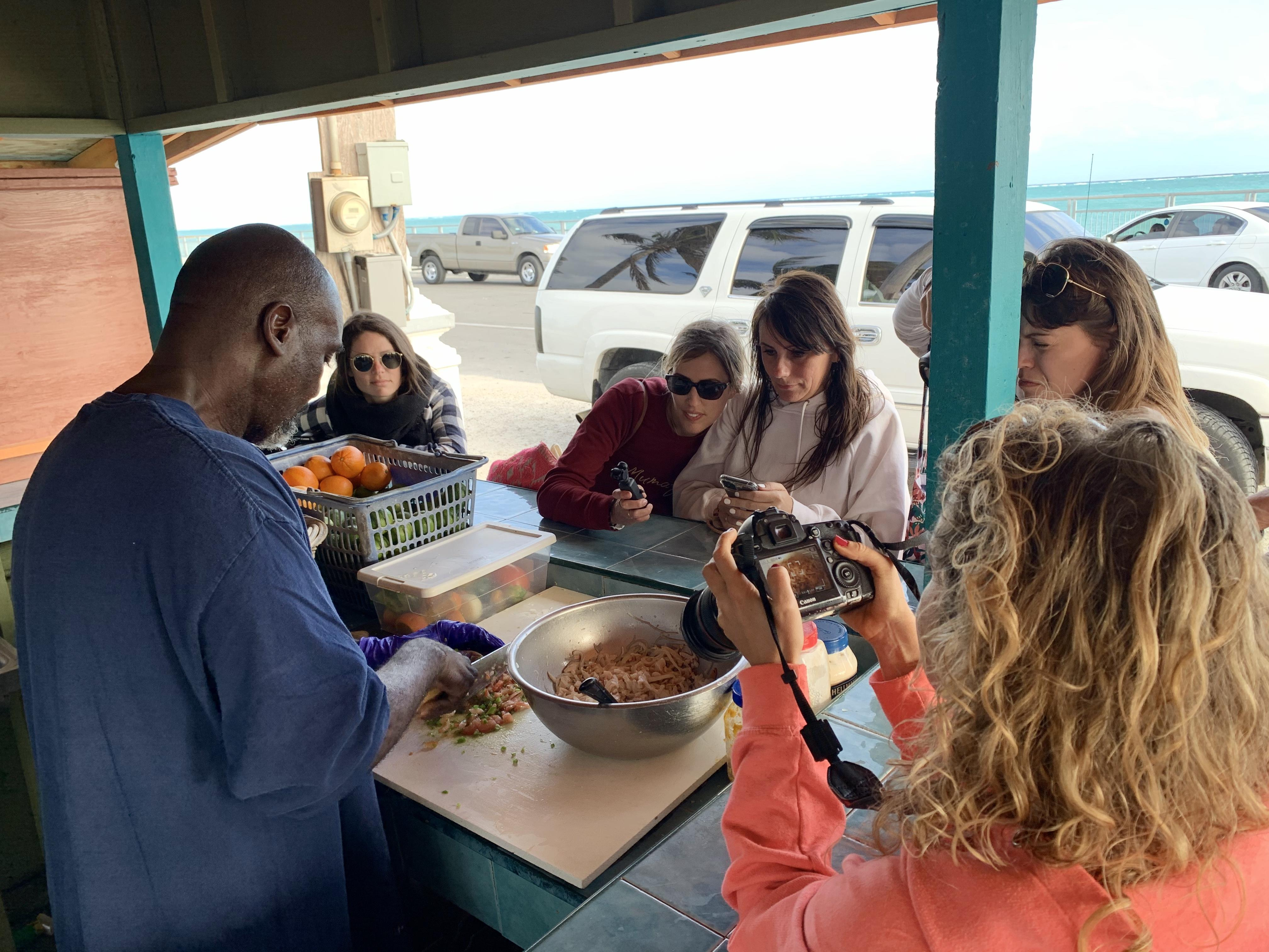 Terry of Terry's Conch Stand in Smith's Point shows his guests how he makes his signature conch salad.