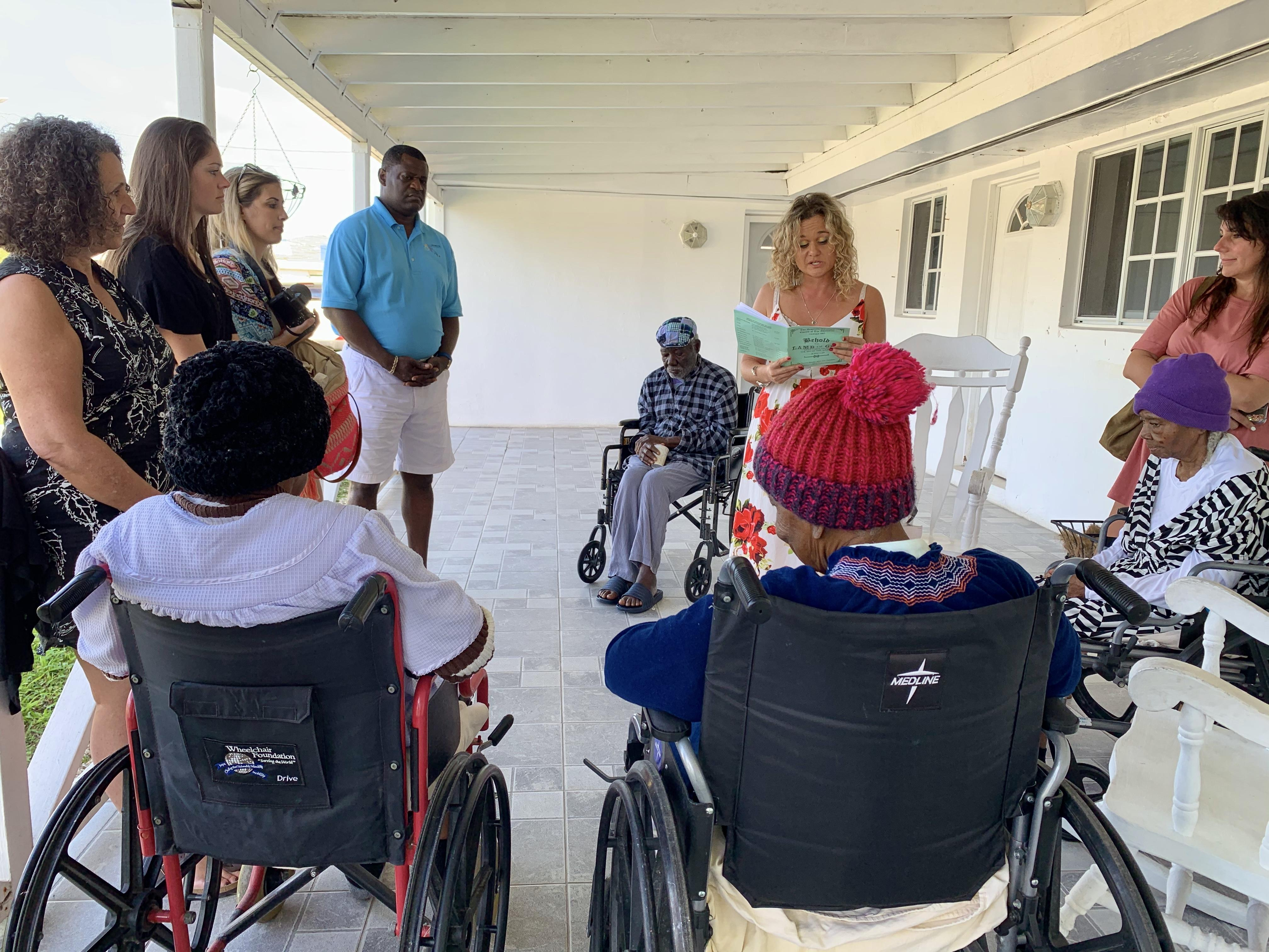 The familiarization tour included a stop to the Grand Bahama Home for the Aged where the visitors spent time reading and socializing with the residents.