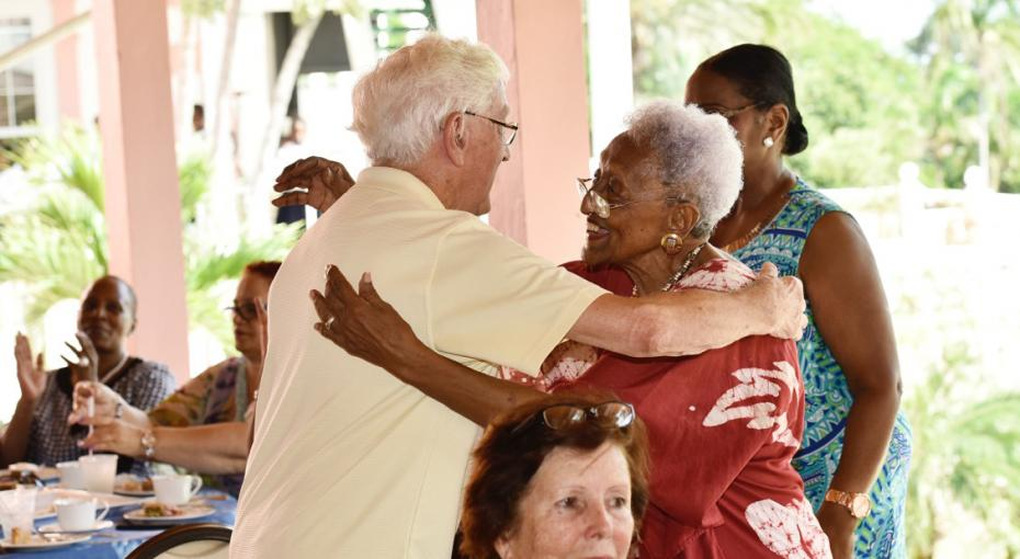 Beverly Wallace-Whitfield embraces a guest at a People-to-People Tea Party
